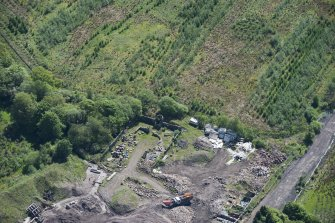 Oblique aerial view of Auchinvole Castle, looking SSE.
