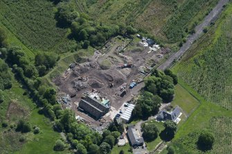 Oblique aerial view of Auchinvole Castle, looking SE.