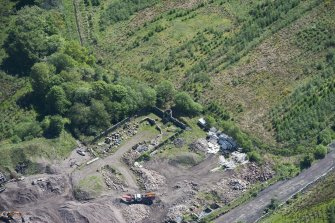 Oblique aerial view of Auchinvole Castle, looking ESE.