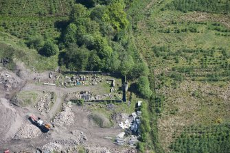 Oblique aerial view of Auchinvole Castle, looking ENE.