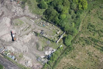 Oblique aerial view of Auchinvole Castle, looking NE.