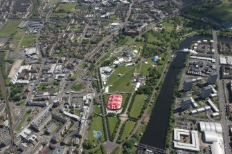 Oblique aerial view of Radio 1's Big Weekend at Glasgow Green, Nelson Monument and People's Palace, looking SE.