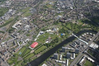 Oblique aerial view of Radio 1's Big Weekend at Glasgow Green, Nelson Monument and People's Palace, looking ENE.