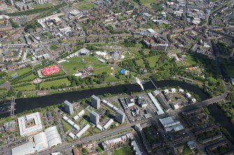 Oblique aerial view of Radio 1's Big Weekend at Glasgow Green, Nelson Monument and People's Palace, looking NE.
