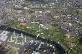 Oblique aerial view of Radio 1's Big Weekend at Glasgow Green, Nelson Monument and People's Palace, looking N.