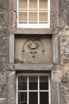 Detail of inscription between 2nd and 3rd floors at Shoemakers' Land, 195-197 Canongate, Edinburgh.
