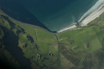 Aerial view from the SE. The farm of Laig is at lower centre. The northern part of the former loch is indicated by uncultivated ground to its right. Between the farm and the shore, on the raised beach, a complex of small square enclosures set in linear patterns is believed to be a Pictish cemetery. (Colin Martin)