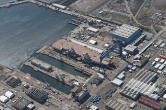 Oblique aerial view of the building of the aircraft carrier, HMS Elizabeth at Rosyth Dockyard, looking WSW.