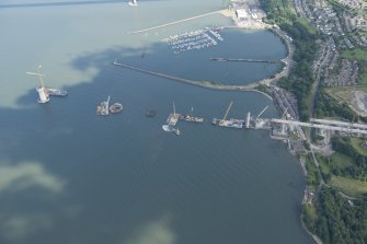 Oblique aerial view of the construction of the Queensferry Crossing and Port Edgar, looking ESE.