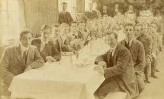 Uncaptioned photograph of a group of people sitting at a table.