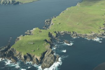 Oblique aerial view of Horns of The Garths, Skaw, Unst, looking W.