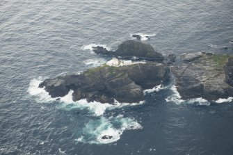 Oblique aerial view of North Unst Lighthouse, Muckle Flugga, looking SE.