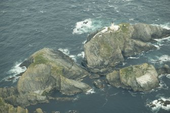 Oblique aerial view of North Unst Lighthouse, Muckle Flugga, looking NW.