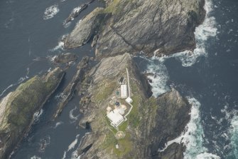 Oblique aerial view of North Unst Lighthouse, Muckle Flugga, looking SSW.