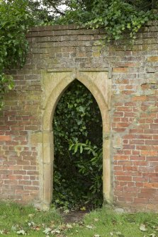 Walled garden. Arched entrance.