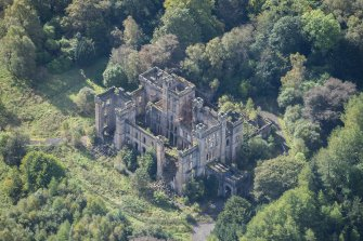 Oblique aerial view of Lennox Castle, looking SSW.