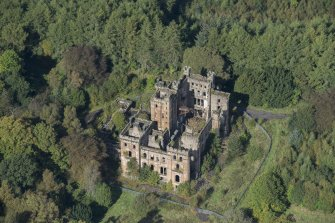 Oblique aerial view of Lennox Castle, looking NW.