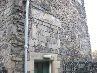 View of altered doorway/window openings on south elevation of Cadell House, Panmure Close, 129 Canongate, Edinburgh.