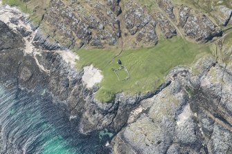 Oblique aerial view of Dun Beag Vaul on Tiree, looking SSW.