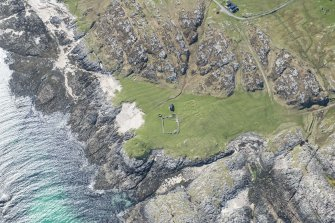 Oblique aerial view of Dun Beag Vaul on Tiree, looking S.