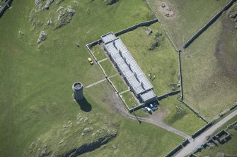 Oblique aerial view of Hynish lighthouse signal tower on the Isle of Tiree, looking S.