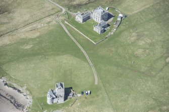 Oblique aerial view of Breachacha House and castle on the Isle of Coll, looking WNW.