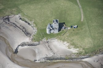 Oblique aerial view of Breachacha Castle on the Isle of Coll, looking WNW.