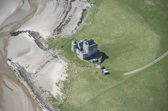 Oblique aerial view of Breachacha Castle on the Isle of Coll, looking SW.