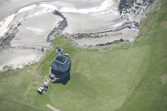 Oblique aerial view of Breachacha Castle on the Isle of Coll, looking S.