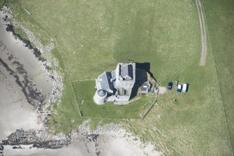 Oblique aerial view of Breachacha Castle on the Isle of Coll, looking W.