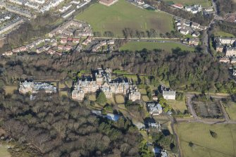 Oblique aerial view of New Craig House, Queen's Craig House, East Craig House, and Old Craig House, looking N.