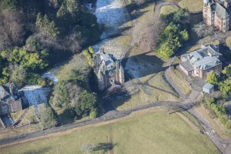 Oblique aerial view of Bevan House and East Craig House, looking NNE.