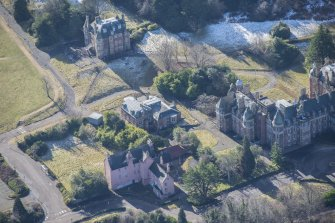 Oblique aerial view of Old Craig House, Bevan House and East Craig House, looking SSW.