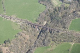 Oblique aerial view of Ballochmyle Railway Viaduct, looking NE.