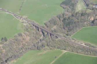 Oblique aerial view of Ballochmyle Railway Viaduct, looking NNE.