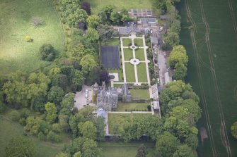 Oblique aerial view of Carlowrie Country House, walled garden, main stable block and Westfield Steading, looking SW.