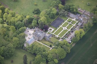 Oblique aerial view of Carlowrie Country House, walled garden, stable block and Westfield Steading, looking SSW.
