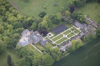 Oblique aerial view of Carlowrie Country House, walled garden, main stable block and Westfield Steading, looking S.