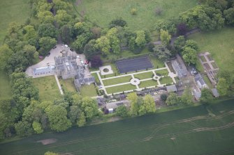 Oblique aerial view of Carlowrie Country House, walled garden, main stable block and Westfield Steading, looking SSE.