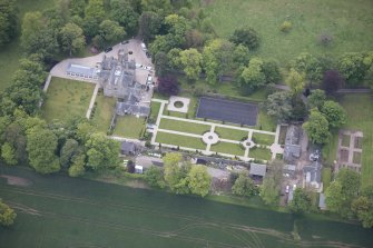 Oblique aerial view of Carlowrie Country House, walled garden, main stable block and Westfield Steading, looking SE.