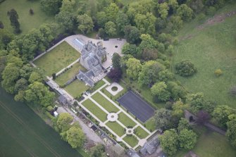 Oblique aerial view of Carlowrie Country House, walled garden, main stable block and Westfield Steading, looking E.
