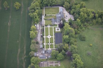 Oblique aerial view of Carlowrie Country House, walled garden, main stable block and Westfield Steading, looking ENE.