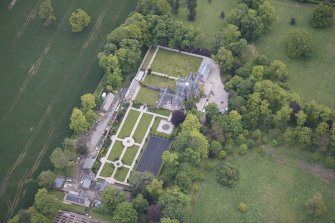 Oblique aerial view of Carlowrie Country House, walled garden, main stable block and Westfield Steading, looking NE.