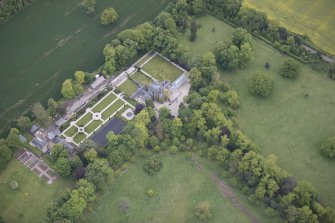 Oblique aerial view of Carlowrie Country House, walled garden, main stable block and Westfield Steading, looking N.