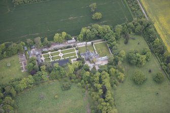 Oblique aerial view of Carlowrie Country House, walled garden, main stable block and Westfield Steading, looking NNW.