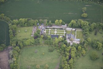 Oblique aerial view of Carlowrie Country House, walled garden, main stable block and Westfield Steading, looking NW.
