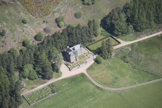 Oblique aerial view of Birse Castle, looking N.
