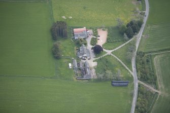 Oblique aerial view of Colquhonnie Hotel and Colquhonnie Castle, looking ESE.