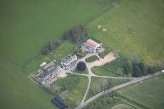 Oblique aerial view of Colquhonnie Hotel and Colquhonnie Castle, looking NE.
