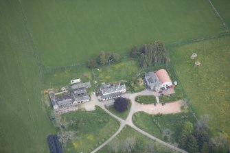 Oblique aerial view of Colquhonnie Hotel and Colquhonnie Castle, looking NNE.